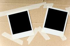 polaroids on box - stock photo