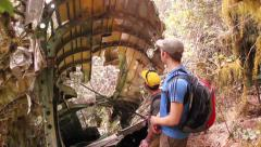 Discovery of plane wreck on hike Stock Footage
