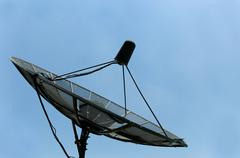 old satellite dish - stock photo