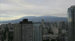 Sunrise Over Vancouver BC City with Grouse Mountain and English Bay Stock Footage