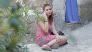 Stock Video Footage of beautiful young woman on a cell phone