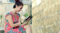 happy young woman using a  tablet Footage