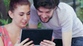 young man and woman having fun using webcam of a tablet computer Footage