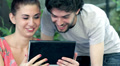 young man and woman having fun using webcam of a tablet computer HD Footage