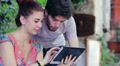 young man and woman having fun using a tablet HD Footage