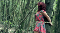 woman kidnapped and tied to a tree shouts ( cries) looking for help - stock footage