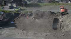 Construction, ground compacting, dusty hot dirty work, wide shot Stock Footage
