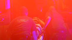 Medical Personnel Loading A Person Into The Back Of An Ambulance For Transport - stock footage