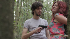 a crazy maniac kidnaps a young woman and torture her with a gun - fear - stock footage