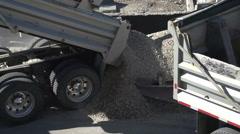 Construction, dump truck unloads gravel at construction site Stock Footage