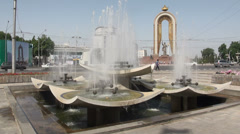 Dushanbe, Somoni statue, fountain, traffic Stock Footage