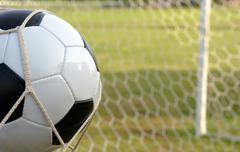 Football - soccer ball in goal Stock Photos