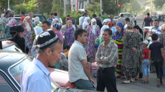 Taxi stand in Dushanbe, third world, crowd, busy, transportation, Tajikistan - stock footage