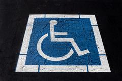 handicapped symbol painted on ashpalt - stock photo