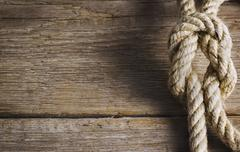 Old wood with rope knot Stock Photos