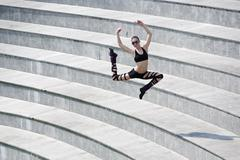 Jumping dancer in arena Stock Photos