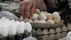 Selling eggs at Khujand bazaar, market, marketplace, sale, Central Asia Stock Footage