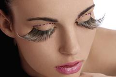 beauty shot with creative makeup with long lashes - stock photo