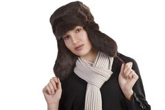 girl with fur hat and with scarf posing towards the camera - stock photo