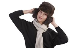 girl with fur hat and with scarf with fun pose - stock photo