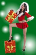 santa claus brunette with 2 presents - stock photo