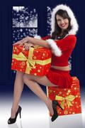 Stock Photo of santa claus brunette with presents