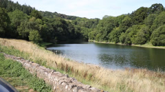 Stock Video Footage of Hawkridge reservoir Quantock Hills Somerset known for trout fishing PAN