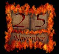 Burning wooden calendar november 25. Stock Illustration