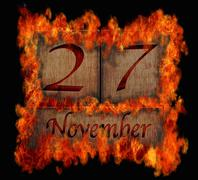 burning wooden calendar november 27. - stock illustration