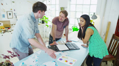 Students or young business partners working together on a joint project Stock Footage
