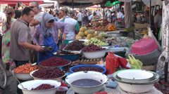 Piles of fresh fruit at Central Asian bazaar Stock Footage