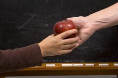 Apple for teacher - handshake variation Stock Photos
