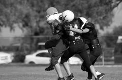 American football - youth - tackle! - black and white variation Stock Photos
