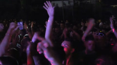 Wild crowd dancing in a outdoor disco -  concert Stock Footage