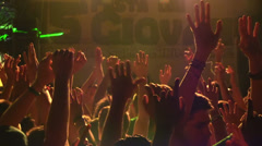 Stock Video Footage of wild crowd dancing in a outdoor disco - concert - hands of crowd at concert