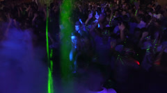 wild crowd dancing in a outdoor disco - concert - ravers - party - stock footage