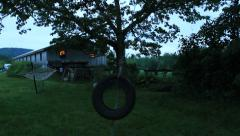 Tire swing at local farm Stock Footage