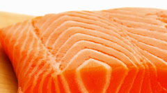 Salmon fish piece on wooden tray isolated on white Stock Footage