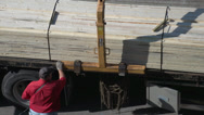 Stock Video Footage of unloading lumber from truck with Hiab arm, close up