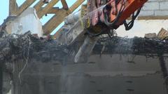 Robotic Machine Arm Crane demolishing Old Building demolition destruction Stock Footage