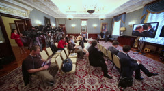Reporters sit in front of TV on Enlarged meeting of Council Stock Footage