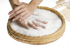 Scrub hands with salt Stock Photos
