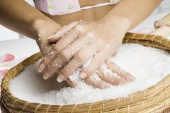 scrub hands with salt - stock photo