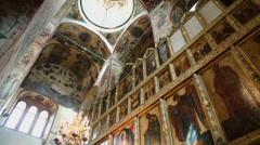 Daylight illuminates interior of church with many icons Stock Footage