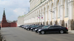 Governmental cars parked near Grand Kremlin Palace and red wall Stock Footage