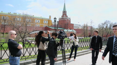 Group of TV reporters work near Kremlin Stock Footage