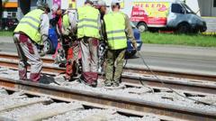 Group of workers repair railroad at Krasnobogaturskaya street Stock Footage