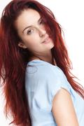 Beautiful young redhead woman. Stock Photos
