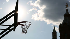 Silhouette of basketball balls which fly into basket - stock footage