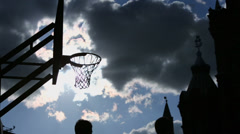 Basketball players which try to put ball into basket Stock Footage
